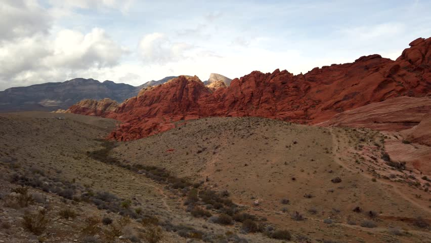 Slow pan of Calico Hills and Guardian Angel in Red Rocks Canyon, Las vegas, Nevada on a sunny spring day.   Shutterstock HD Video #1029299981