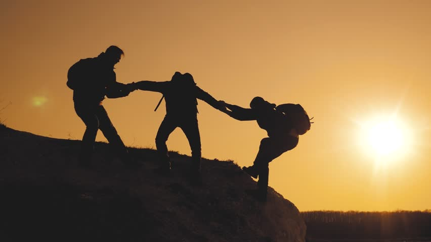 teamwork lifestyle help business travel silhouette concept. group of tourists lends a helping hand climb the cliffs mountains. people climbers climb to the top overcoming hardships the path to victory #1029308651