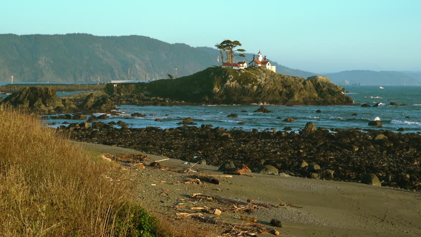Daytime footage of Battery Point Lighthouse in Crescent City, California, USA. Camera zooming out.