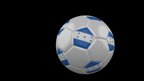 Soccer ball with the flag of Honduras flies past the camera, slow motion, 4k footage with alpha channel