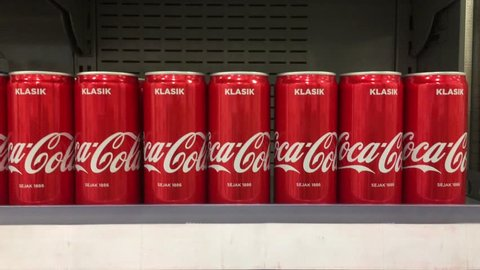Rawang, Malaysia - 12 May 2018 : Close up a Coca Cola can drink on display in a grocery store. Coca Cola Company is leading manufacturer of soda drinks in the world.