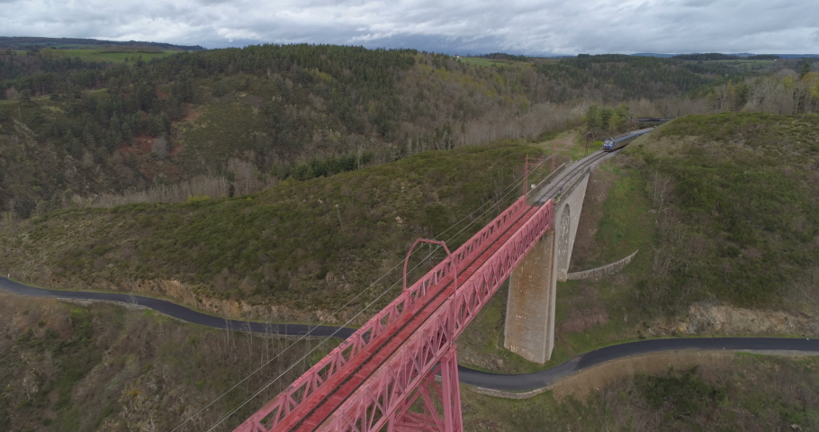 Train approaching and crossing Garabit bridge - aerial shot | Shutterstock HD Video #1029357521