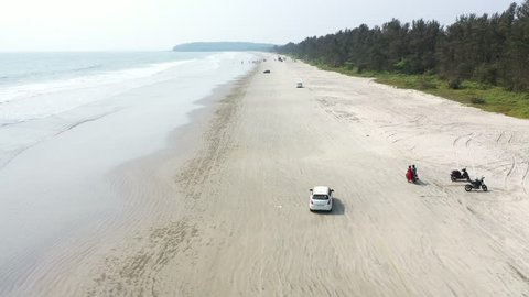 Muzhappilangad Drive-In Beach in India Kerala with some light traffic.