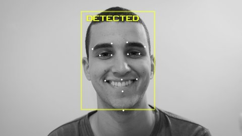 Black and white - man has his face and emotion detected by artificial intelligence as happy