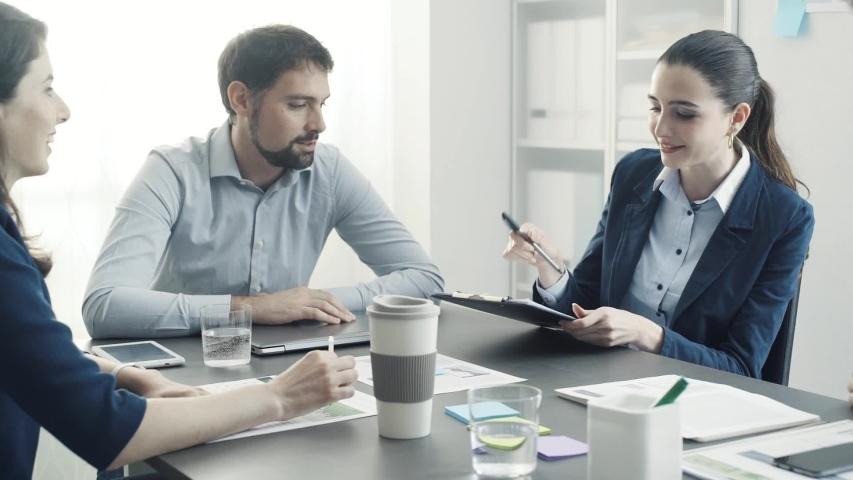 Cheerful successful business team giving a high five, teamwork and achievement concept | Shutterstock HD Video #1029501371