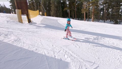 Keystone, Colorado, USA-January 5, 2019 - Slow motion. Little girl learning how to ski down the hill on alpine mountains.