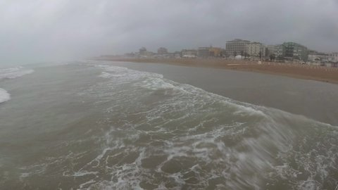 Extreme wind and rain on the beach. Storm on the Adriatic Sea.