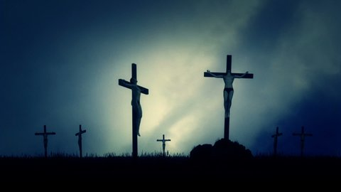 Crucified Men Nailed to a Cross Under in a Field