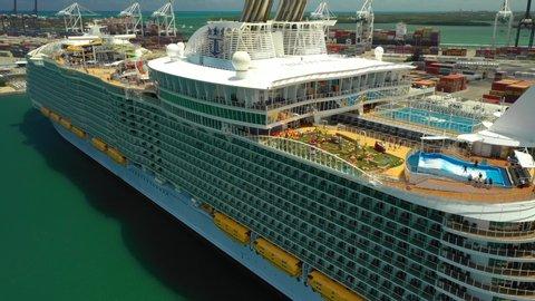 MIAMI, FL, USA - MAY 15, 2019: Summer vibes Symphony of the Seas Royal Caribbean cruise ship Miami aerial 4k