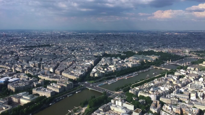 Time lapse of the view of Paris, the Seine, and the bustling streets below from the top floor of the Eiffel Tower | Shutterstock HD Video #1029738881