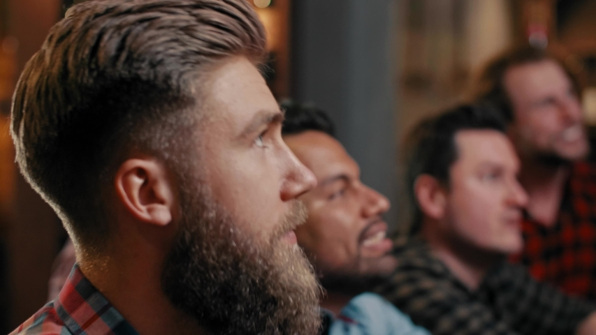 Unhappy men while watching american football | Shutterstock HD Video #1029817721