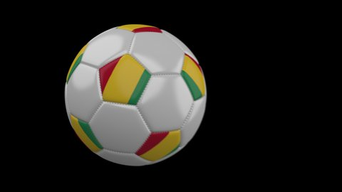 Soccer ball with flag Guinea flies past camera, slow motion blur, 4k footage with alpha channel