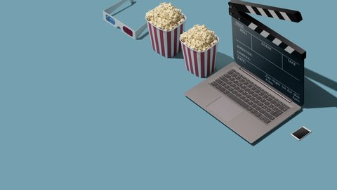 Online movie streaming and cinema: laptop with clapperboard as screen, popcorn and 3D glasses, blank copy space