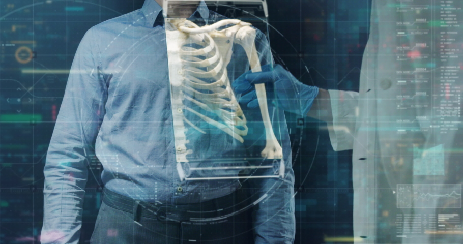 Slow motion of futuristic doctor is examining his patient's skeleton with newest technology scanning with augmented reality holograms in modern laboratory. | Shutterstock HD Video #1029921071