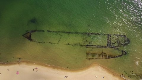 Top down aerial view of shipwreck at sea shore