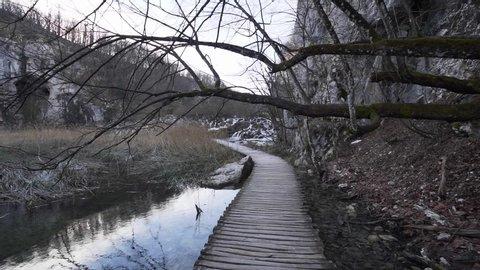 Plitvice Lakes Walking Point Of View Shot Along National Park Boardwalk Towards Waterfalls In Winter