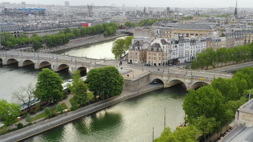 Aerial drone view of Paris, Seine river, Pont des Arts and Square du Vert-Galant   Shutterstock HD Video #1030076411