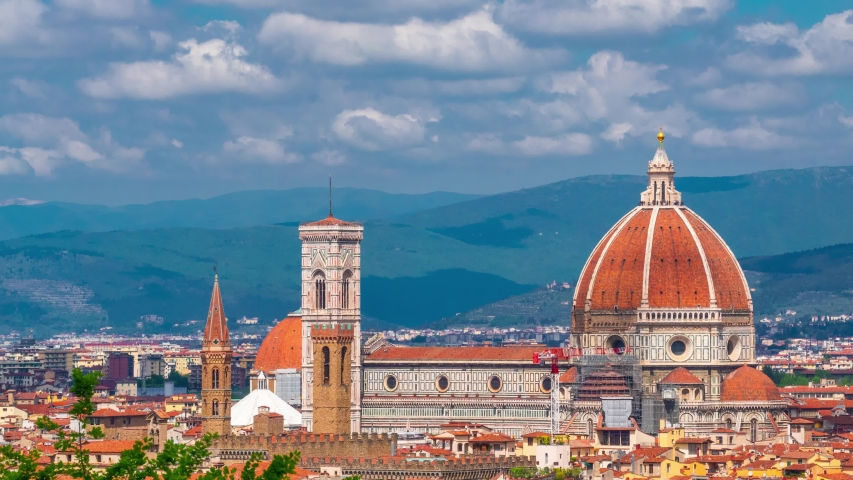 Florence, Tuscany, Italy. Cityscape of the city with Florence Cathedral, formally the Cattedrale di Santa Maria del Fiore. Time lapse. Camera moves from left to right | Shutterstock HD Video #1030139441