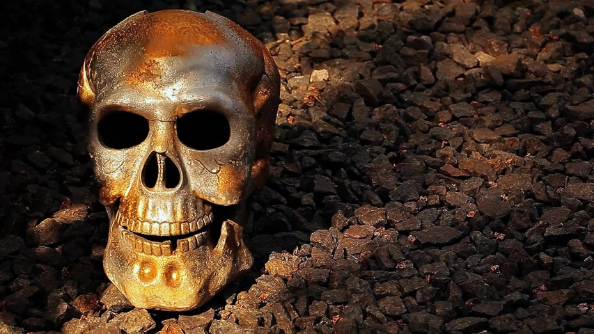 Skull natural stone background shadow  | Shutterstock HD Video #1030197281