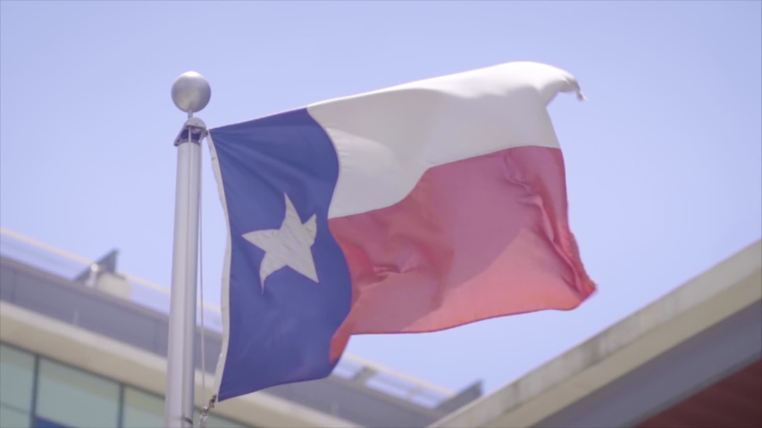 A Texas state flag flaps in the wind at 20% slow motion | Shutterstock HD Video #1030219931