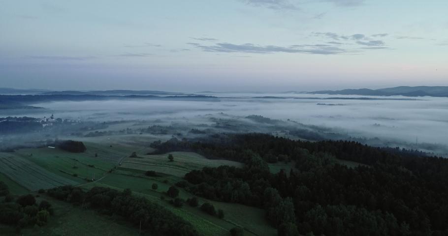 Drone footage of the foggy sunrise in Bieszczady. | Shutterstock HD Video #1030240241
