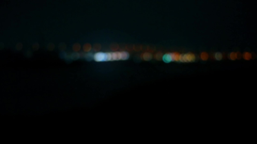 Abstract blurred and bokeh image of city lights from the train window at night. | Shutterstock HD Video #1030246691