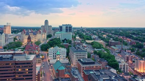 Drone footage of Albany, New York downtown at dusk, with rotating camera motion. Albany is the capital city of the U.S. state of New York and the county seat of Albany County