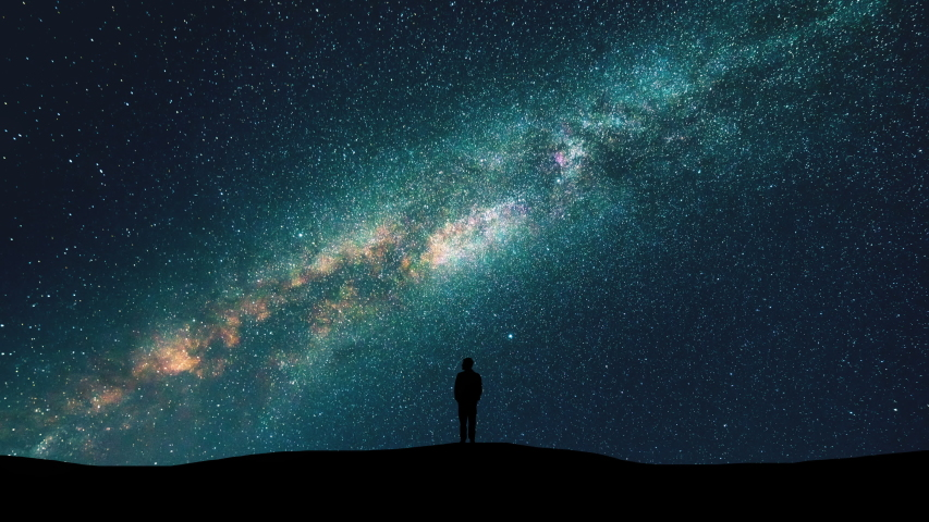The man silhouette on the starry sky background. time lapse #1030440101