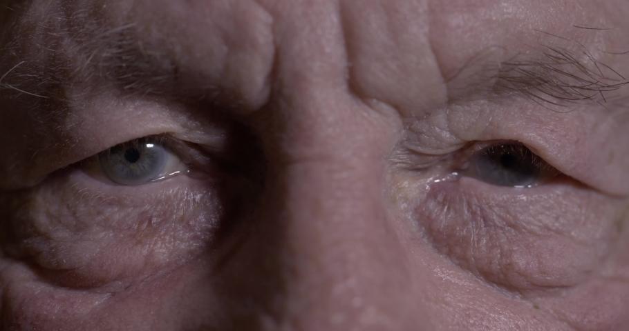 Seniors eyes close up, contemplative old caucasian man staring at camera. Macro | Shutterstock HD Video #1030477871