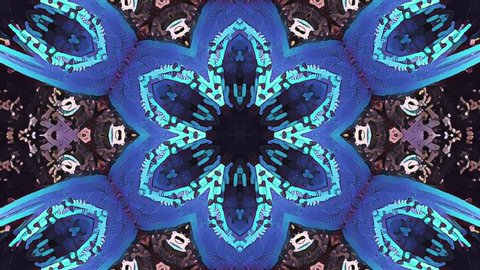 Abstract kaleidoscope pattern with turquoise, purple, blue, blue and green colors. Magic mandala. 4k Abstract multicolored motion graphics background. Seamless loop. Fractal animation.