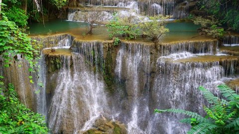 Waterfall flow standing with forest enviroment high angle view in thailand called Huay or Huai mae khamin in Kanchanaburi Provience, Thailand., .