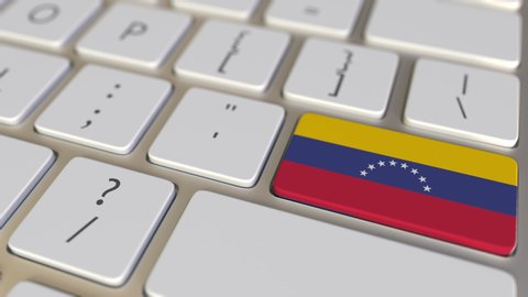 Key with flag of Venezuela on the computer keyboard switches to key with flag of the USA, translation or relocation related animation