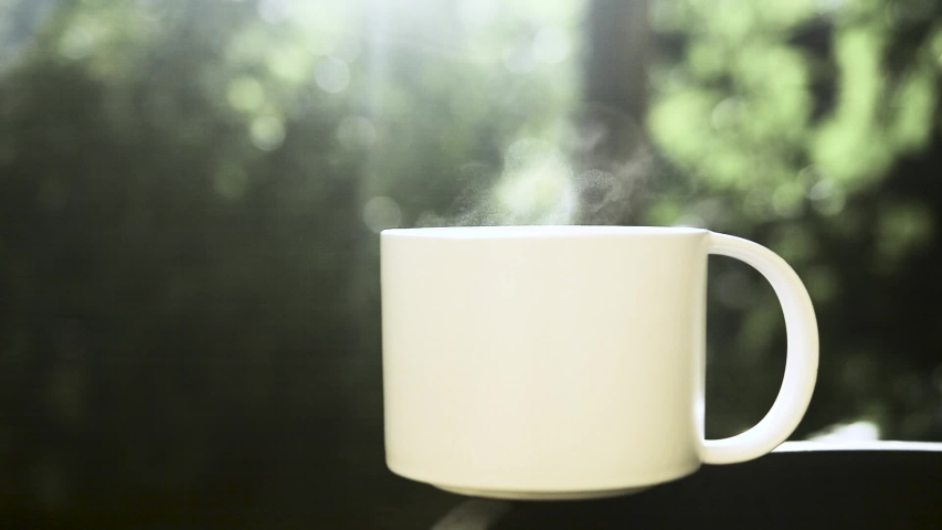 White cup coffee whit Steam on nature background. | Shutterstock HD Video #1030725641
