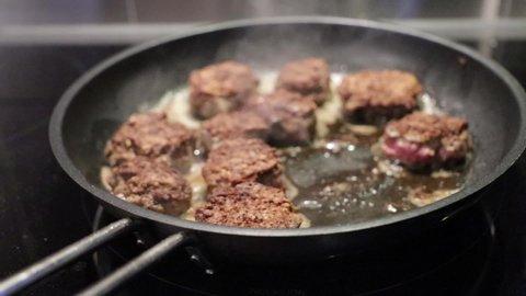 cook meatballs in frying pan