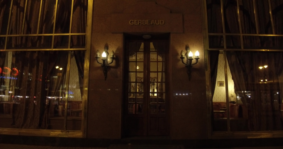 Budapest, Hungary - 11 11 2018: The famous Gerbeaud Cafe on Vorosmarty Square at night in Budapest. | Shutterstock HD Video #1030837241