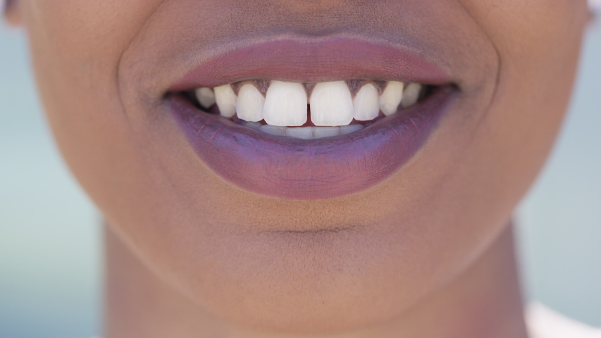Close up of young black female mouth talking to camera | Shutterstock HD Video #1030837361