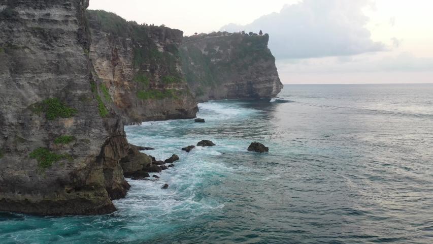Waves break rocks, videos from drone Mavic2 Pro. | Shutterstock HD Video #1030855391