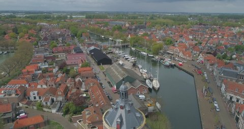 Aerial pulling back from the Drommedaris Defence tower in historic Dutch town Enkhuizen in North Holland the Netherlands
