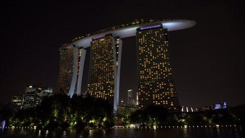 SINGAPORE CITY, SINGAPORE - MARCH 28, 2019: Marina Bay Sands is an integrated resort fronting Marina Bay at night view, establishing shot