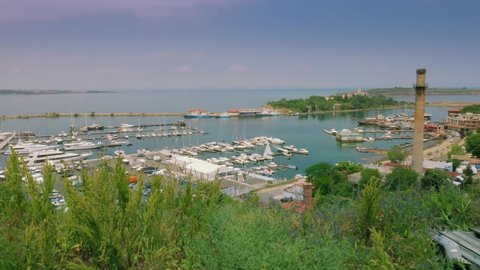 Aerial view of port for luxury yachts, boats and sailboats from above. Drone shot Sozopol landscape with boats and small old town