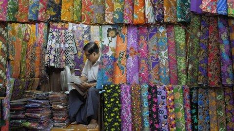 Yangon, Myanmar - 18.05.2019: Textile and cloth selling on Bogyoke Aung San Market at Yangon. Bogyoke or Scott Market is one of most popular bazaar in Yangon.