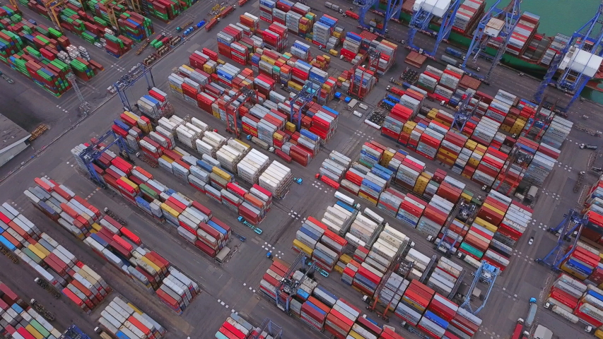 Aerial top view of container cargo ship in the export and import business and logistics international goods in urban city. Shipping to the harbor by crane in Laem Chabang, Chon Buri, Thailand | Shutterstock HD Video #1031161451