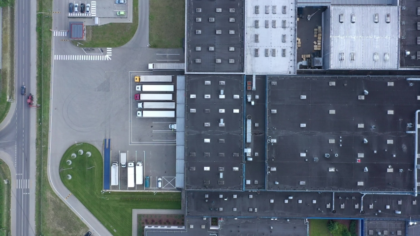 Aerial view of the logistics warehouse with trucks waiting for loading #1031167541