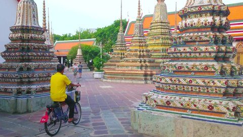 BANGKOK, THAILAND - APRIL 22, 2019: The ornate Phra Chedi Rai stupas (chedis), decorated with colorful relief porcelain patterns, located in Wat Pho complex, on April 22 in Bangkok