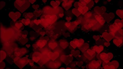 Animation of Beautiful red hearts over a black backdrop. Valentine's day motion background. Red hearts floating dust Particles on the black background.Holiday abstract.