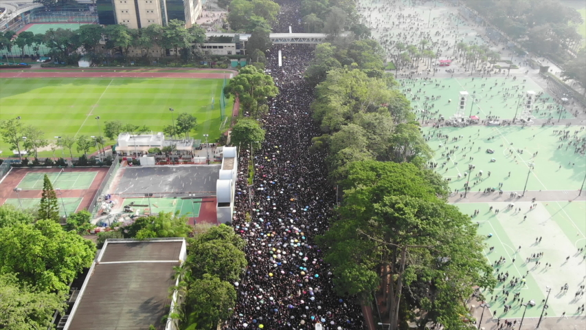Hong Kong -June 16 2019: 2 million protesters stand out to oppose a controversial extradition bill which may include china. since June 9, hong kong people keep protest to against the extradition law. | Shutterstock HD Video #1031567771