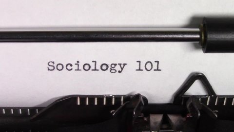 "A close up video of the words ""Sociology 101 "" being typed on white paper in an old manual typewriter. Shot in macro."