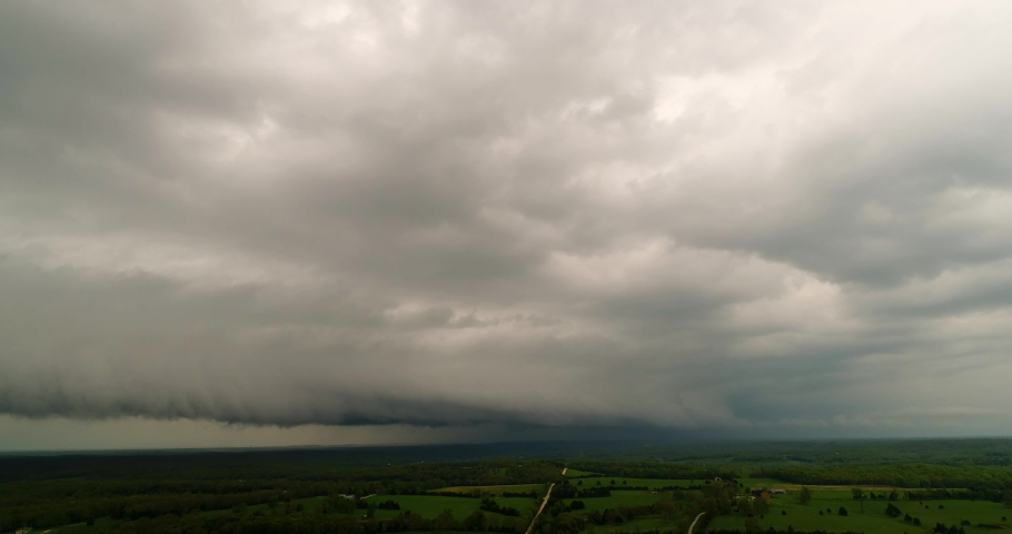 Thunderstorm squall line approaches an area from an aerial view | Shutterstock HD Video #1031786261