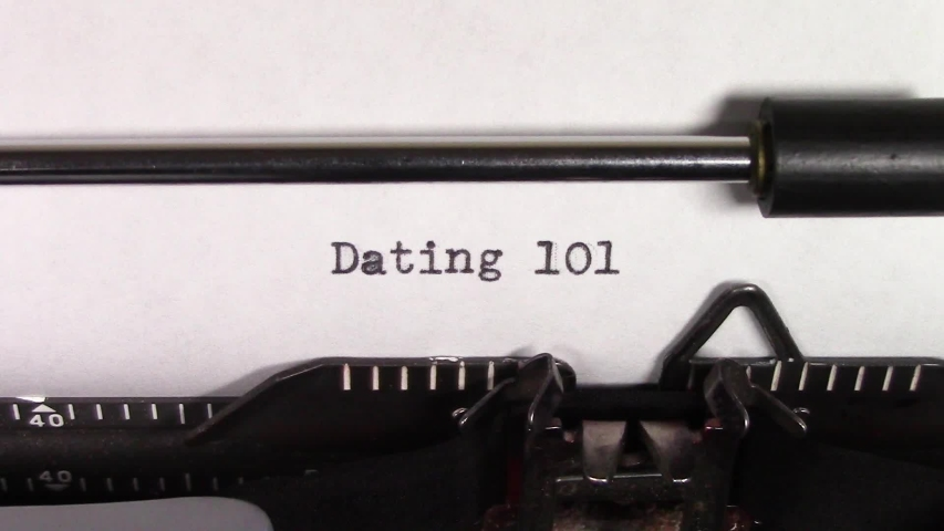 """A close up video of the words """"Dating 101 """" being typed on white paper in an old manual typewriter. Shot in macro.   Shutterstock HD Video #1031830481"""