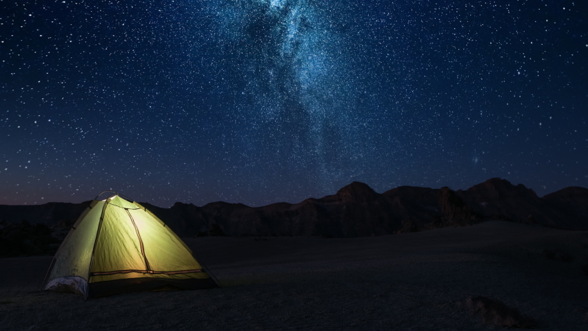 Adventure romance night time and meeting dawn in a tourist tent on a starry night high in the mountains before dawn | Shutterstock HD Video #1031875091